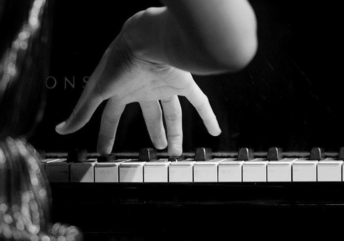 hands of pianist performing in Taos, NM