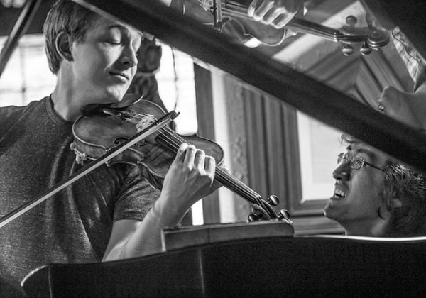 Violinist and pianist having fun practicing chamber music at the Hotel St. Bernard